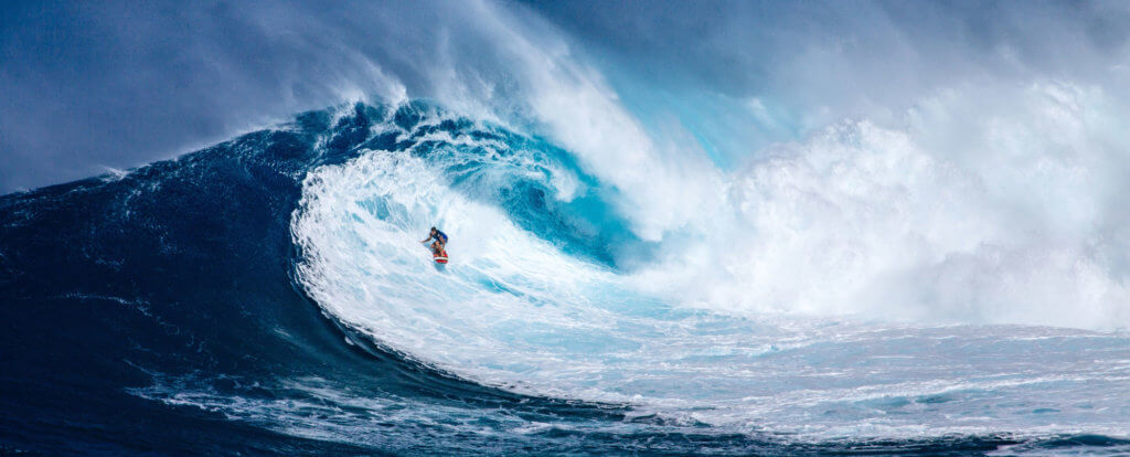 Solo Surfer in the Barrel of a Wave